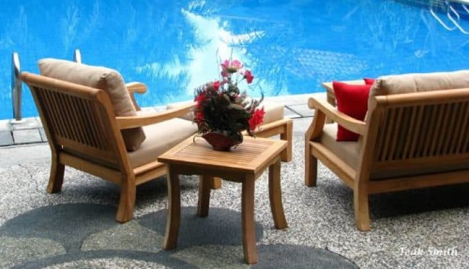 Teak chair near pool